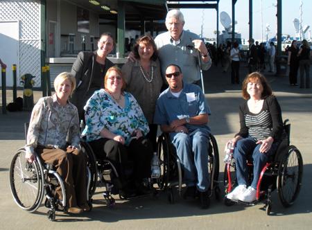 Front Row: DMC Independent Staffers Cheryl Hopper, Christie Rudder, Erik St. Amant, and Candy McElroy. Back Row: DMC Executive Director Delores Kollmer, Misha Houser (LIBOC), and Ken Schaap