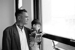 Norberto Santana with his son Maximo at the as-yet-unlaunched Voice of OC's office. Photo: Jonathan Ho