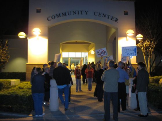 About 50 residents rally ouside Tustin City Council in response to Mayor Jerry Amante and Councilman Doug Davert's comments regarding a mailer sent out during election season. Tustin resident Charles Horvath spoke about the mailer during the Nov. 2 council meeting and the two responded during the meeting, which is broadcast in Tustin and online.