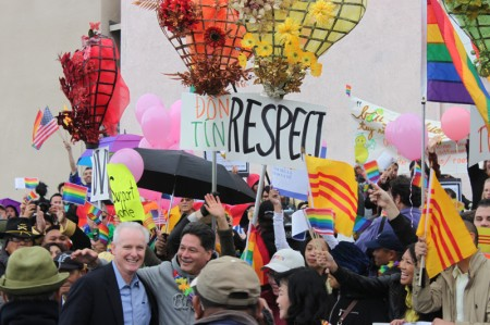Assemblyman Tom Daly (light-blue shirt) takes a moment away from participating in the 2013 Tet Parade to recognize demonstrators in solidarity with the Partnership of Vietnamese LGBT Organizations. To the right of Daly is Democratic Party of Orange County Chairman Henry Vandermeir. (Photo: Chris Prevatt)